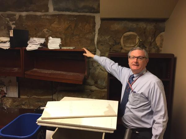 Raney Gilliland points out damage to Statehouse offices of legislative researchers. A 10-inch pipe that carries rainwater from the Statehouse roof failed during storms early Friday.