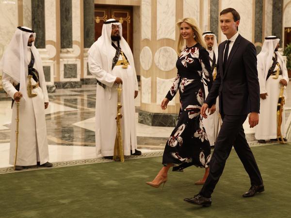 White House adviser Jared Kushner (right) walks with Ivanka Trump at the Royal Court Palace on Saturday in Riyadh.