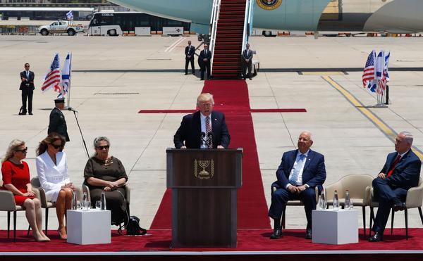 President Trump speaks at a welcome ceremony at Ben Gurion International Airport in Tel Aviv, Israel, on Monday, as Sara Netanyahu (from left), Melania Trump, Nechama Rivlin, Israeli President Reuven Rivlin and Israeli Prime Minister Benjamin Netanyahu listen.