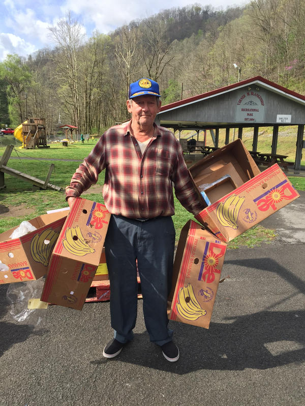 Abraham Lincoln Lester, 83, worked in the coal mines in southwest Virginia for 39 years before retiring. He says such jobs are now scarce, and hunger has become a big problem in the area. Lester goes to the mobile food pantry in Hurley for food and empty boxes, which he uses later.