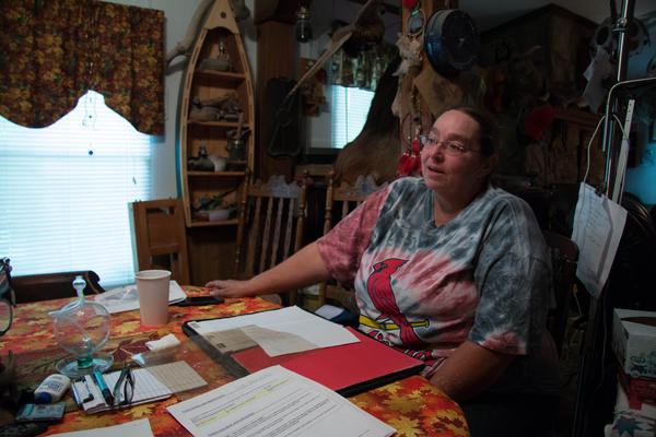 """I know there's got to be more people out there than just me who cannot get health care,"" Corla Morgan says while sitting at her sister's dining room table in Higbee, Mo."
