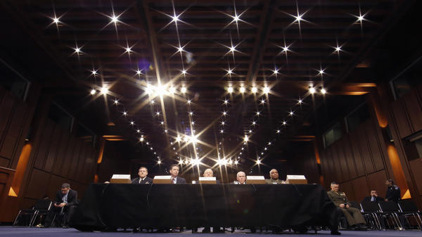 From left, National Security Agency Director Adm. Mike Rogers, former FBI Director James Comey, former Director of National Intelligence James Clapper, ex-CIA Director John Brennan, and Defense Intelligence Agency Director Lt. Gen. Vincent Stewart participate in the Senate Intelligence Committee's hearing on worldwide threats last year.