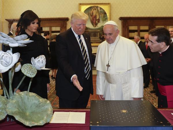 Pope Francis exchanges gifts with President Trump and his wife, Melania, at the Vatican on Wednesday.