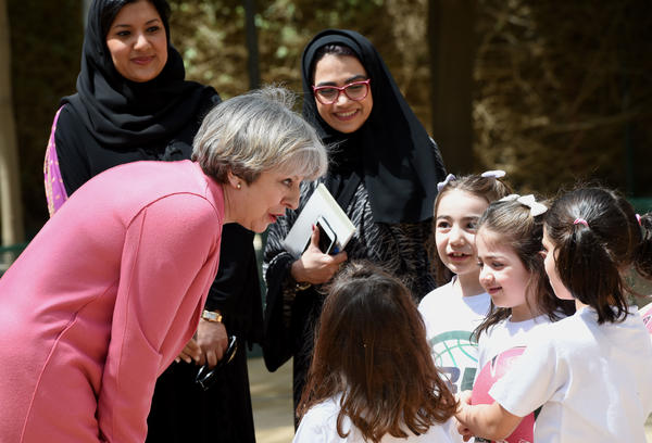 British Prime Minister Theresa May chats with Saudi girls during a basketball class while on a visit to Riyadh last month.