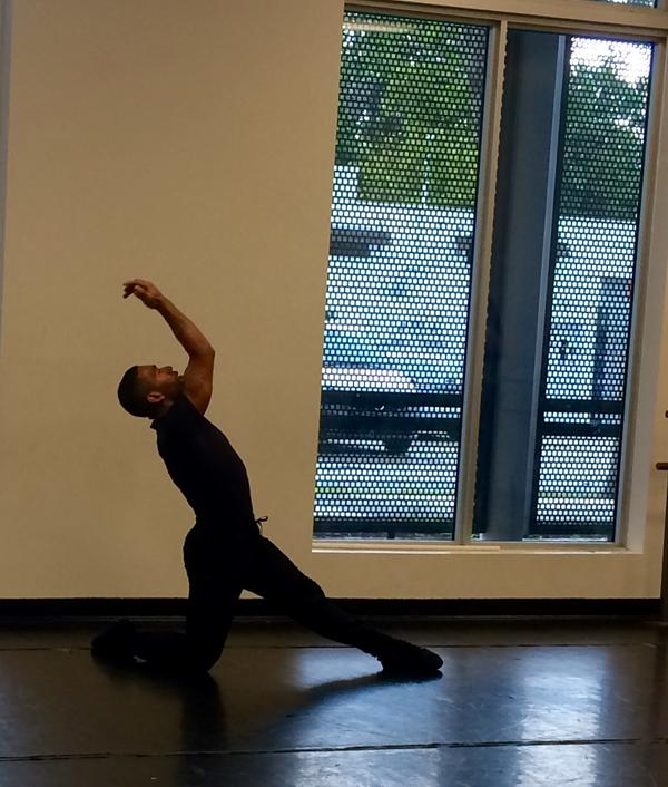 Anthony Velasquez dances the lead male role, representing Edward Stierle, in a rehearsal for 'Lacrymosa.'