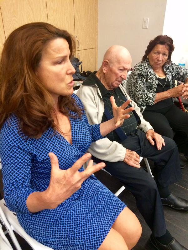 Rosemarie Worton, Edward Stierle's sister, discusses his dance, sitting next to her parents, Bill and Rose Stierle.