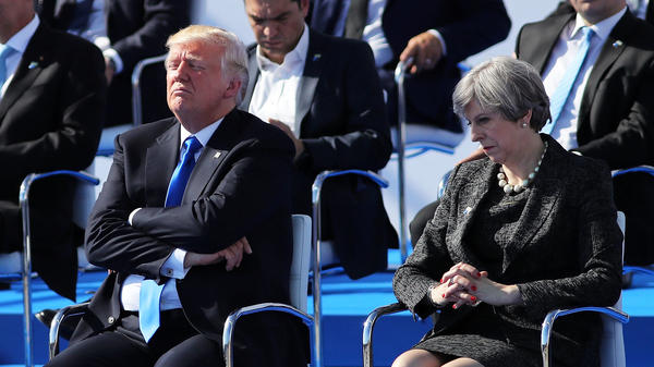 President Donald Trump and British Prime Minister Theresa May await a photo opportunity at a NATO summit meeting in Brussels on Thursday.