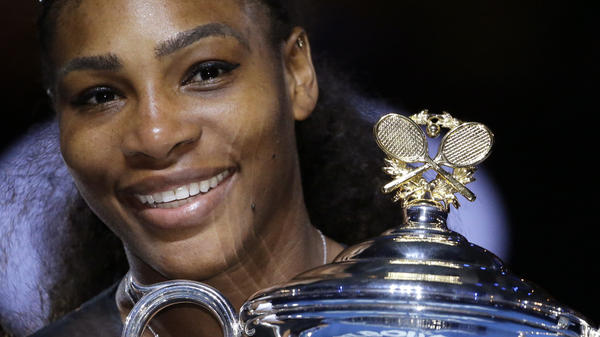 Serena Williams holds her trophy after winning the women's singles final at the 2017 Australian Open.