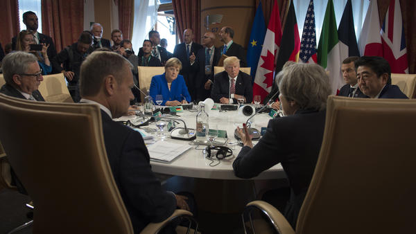 German Chancellor Angela Merkel, President Trump and British Prime Minister Theresa May hold discussions during the G-7 summit in Taormina, Italy, on Friday.