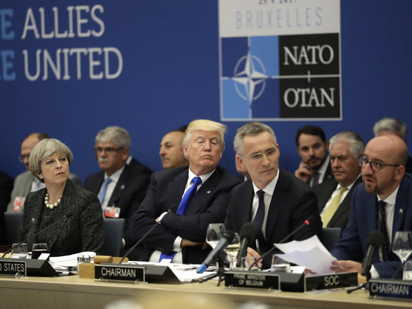British Prime Minister Theresa May, U.S. President Trump and NATO Secretary-General Jens Stoltenberg listen to Belgian Prime Minister Charles Michel as he speaks during a working dinner meeting at the NATO headquarters during a NATO summit of heads of state and government in Brussels on Thursday.