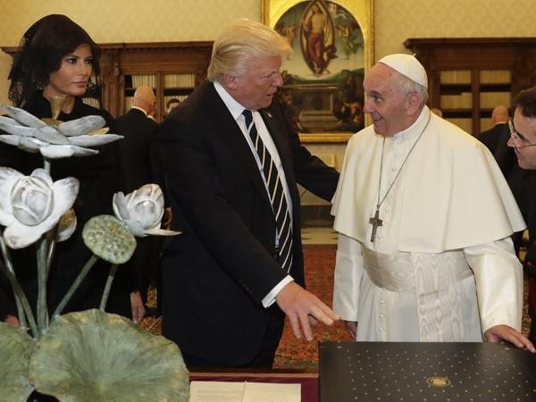 Pope Francis exchanges gifts with President Trump and first lady Melania Trump, on the occasion of their private audience, at the Vatican on Wednesday.