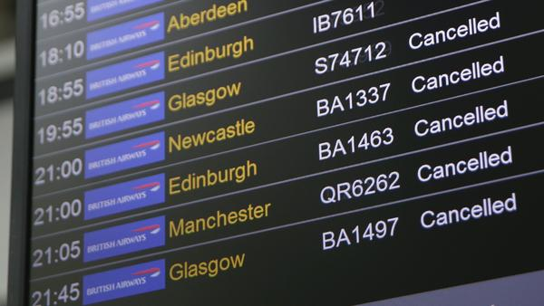 A board at Heathrow Airport in London displays a slew of cancellations for British Airways flights on Saturday. An IT systems failure laid waste to flyers' plans at the U.K.'s two major airports over the weekend, and the situation is yet to be completely resolved as of Monday.