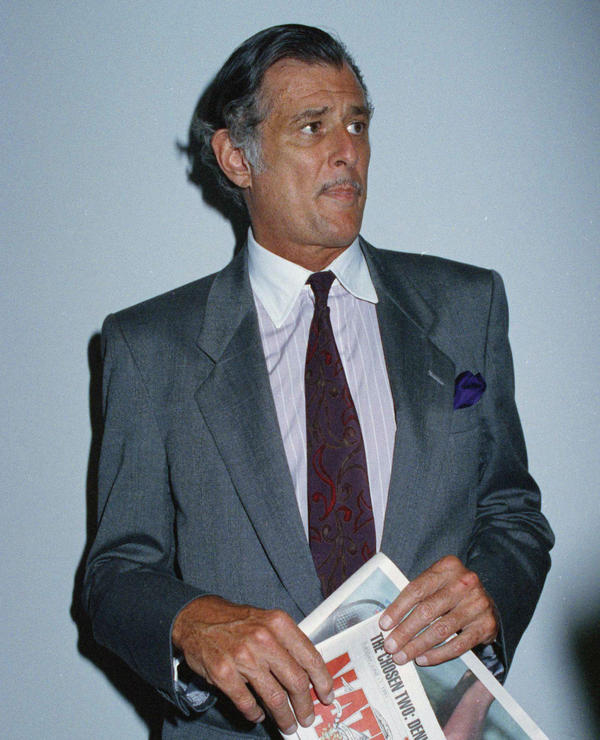 "Frank Deford in 1991, holding a dummy copy of the final edition of <em>The National Sports Daily</em>, which he edited and published. It's hard to distill 37 years of Deford's sports commentaries down to a few ""best of"" pieces. But, before he retired, he shared some of his favorites with us."