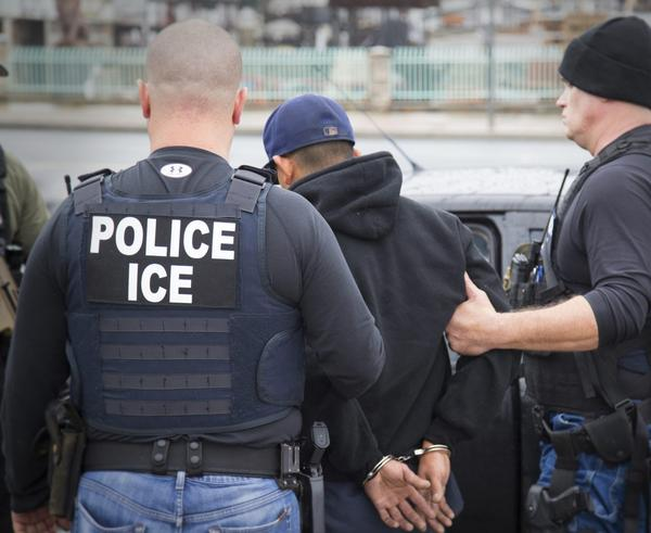 In this Feb. 7, 2017 photo released by U.S. Immigration and Customs Enforcement, an ICE operation is conducted in Los Angeles. (Charles Reed/U.S. Immigration and Customs Enforcement via AP)
