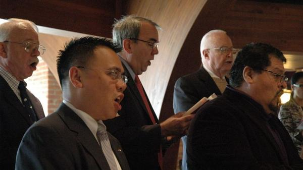 Members of the St. Agnes Catholic Church choir sing during Sunday Mass. From left to right: Donald Hukle, Ray Valido, Richard Samp, Jack Grace and Ben Robles.