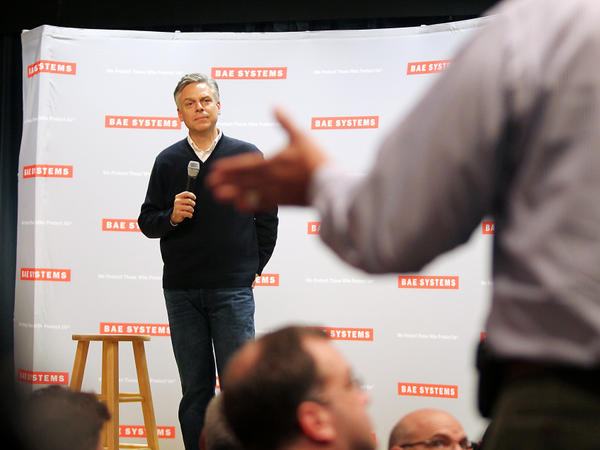 Republican presidential candidate Jon Huntsman takes questions during a town hall meeting at BAE Systems in Nashua, N.H., on Tuesday.