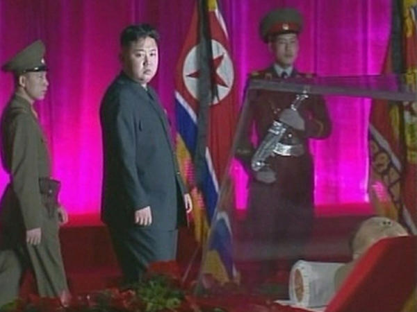 Kim Jong Un (center) pays his respects to his father, former leader Kim Jong Il, who is lying in state at the Kumsusan Memorial Palace in Pyongyang in this still picture taken from video footage aired by Korean Central TV of North Korea on Dec. 20.