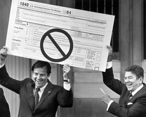 In 1985, then-New Jersey Gov. Thomas Kean and President Ronald Reagan hold an oversized income tax form in Bloomfield, N.J. Reagan was pushing changes to the tax code that were later enacted.