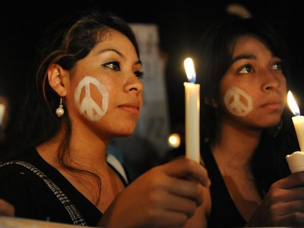 University students take part in a wake against violence held in Tegucigalpa, Honduras, in October. According to the United Nations, Honduras is the most violent country in the world.