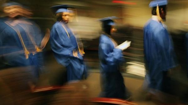 "In Cleveland, 2010 GED graduates from the Get On Track program parade down the aisle during their commencement. In today's economy, some experts say, the GED may not be enough to provide ""gainful employment."""
