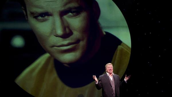 William Shatner in <em>Shatner's World: We Just Live In It</em> on Broadway at the Music Box Theatre. In the 90-minute show, Shatner illustrates some of his stories with photos and video clips.