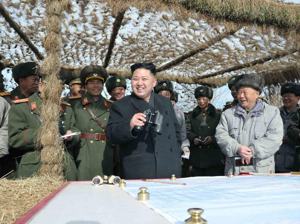 North Korean leader Kim Jong Un (center) inspects army units at an undisclosed location in this photo released by the Korean Central News Agency on Monday.