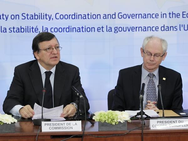 European Commission President Jose Manuel Barroso (left) and European Union President Herman Van Rompuy open a ceremony to sign an economic treaty Friday.