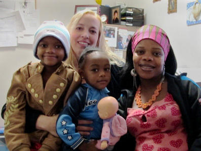 Nowela Virginie and her daughters often visit social worker Marcia Munden at Catholic Charities of Idaho.