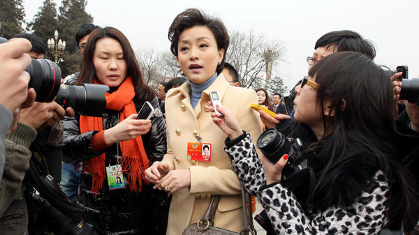 "Yang Lan, TV host and delegate to the Chinese People's Political Consultative Conference, carries a Marc Jacobs handbag outside the Great Hall of the People in Beijing on March 3. Nicknamed ""the Oprah Winfrey of China,"" Yang has also been seen wearing a Giorgio Armani jacket during the legislative session."