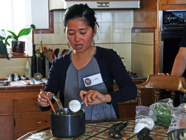 Linh Nguyen teaches the traditional Vietnamese recipes she learned from her mother and aunts to students at a Culture Kitchen class.