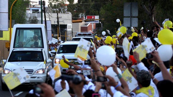 Pope Benedict XVI arrives in his popemobile at Miraflores College in Leon, in the Mexican state of Guanajuato, on Friday.