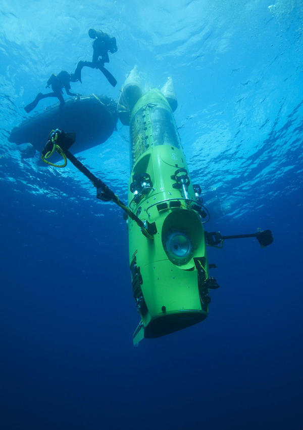 The Deepsea Challenger submersible begins its first test dive off the coast of Papua New Guinea.