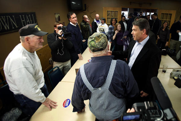 Texas Gov. Rick Perry speaks to local residents during a campaign stop at the Pizza Ranch restaurant, Monday, Dec. 19, 2011, in Manchester, Iowa.