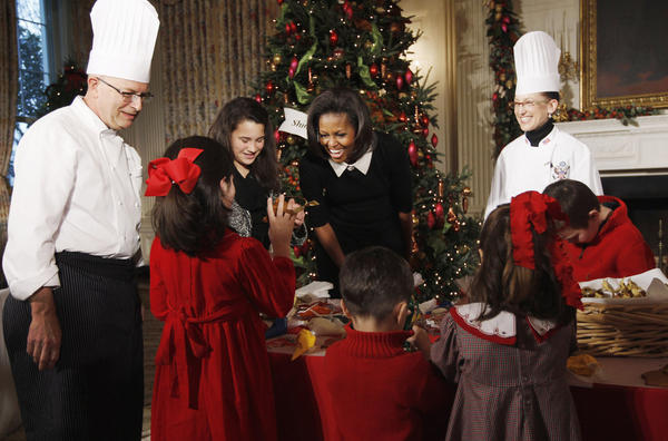 First lady Michelle Obama welcomed military families to the first viewing of the 2011 decorations on Wednesday. White House chefs joined her to decorate cookies with the children.