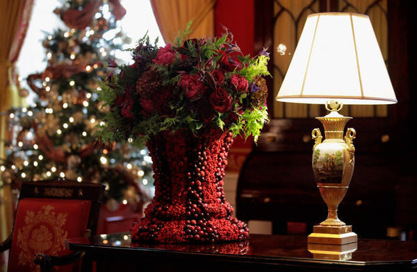 The Red Room features fruit, foliage and flowers set in berry-covered vases.
