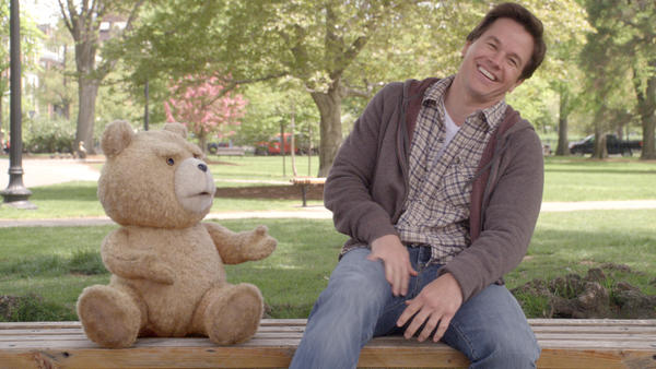 Ted (voiced by writer-director Seth MacFarlane) and Johnny (Mark Wahlberg) share a laugh in <em>Ted. </em>The talking teddy bear got his powers when 8-year-old Johnny wished upon a falling star for Ted to speak.<em></em>
