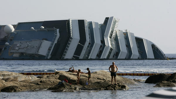 Work has begun to remove the tons of rocky reef embedded into the Concordia cruise ship's hull, off Giglio Island in Italy. The plan is to eventually tow the wreck away from the island in one piece.
