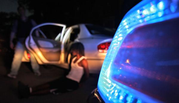 The Chicago police gang enforcement unit makes an arrest after stopping a car with four suspected gang members in June.