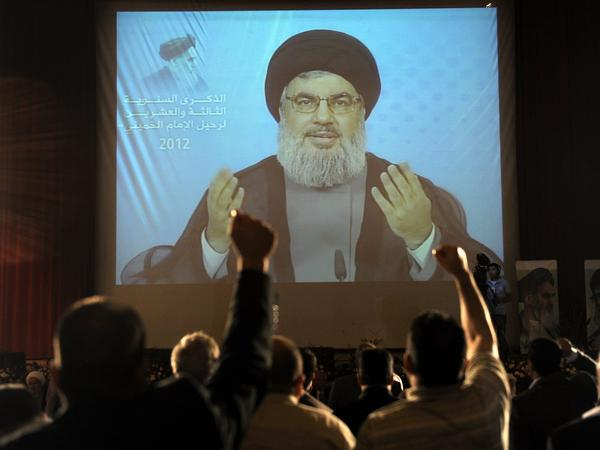 Hezbollah leader Sayyed Hassan Nasrallah, seen here delivering a speech via video in Beirut in June, has dismissed Assir's calls for disarmament.
