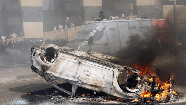 A car burns after riots break out in front of a luxury hotel in central Cairo on Aug. 2. Cairo and other parts of Egypt have seen an increase in crime and lawlessness since the country's revolution last year.