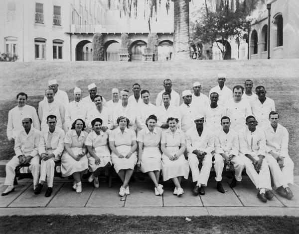 An image of attendants, circa 1949.