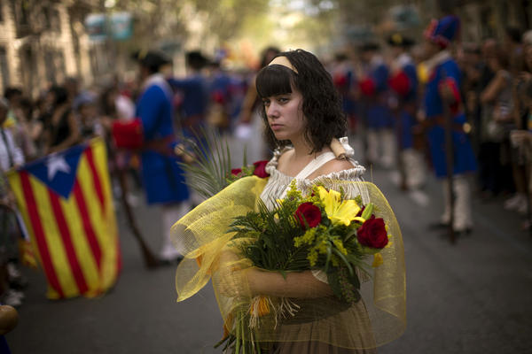 A woman in traditional Catalan dress participates in National Day demonstrations in Barcelona on Sept. 11.