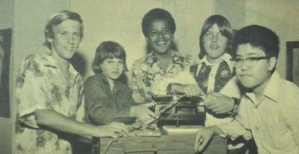 "Barack Obama in a 1975 photo from the Punahou School yearbook. He and his eighth-grade homeroom classmates pose with a slide projector as part of the yearbook's theme of ""Nostalgia."""