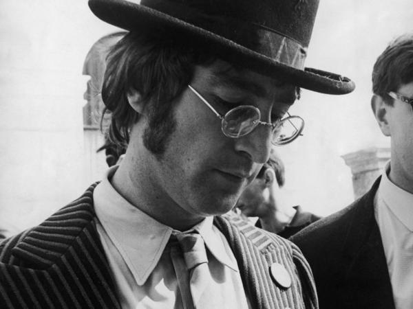 John Lennon signs autographs during the filming of <em>The Magical Mystery Tour</em>.