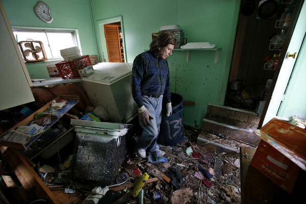 Steve Santo stands in what used to be the kitchen of his house after it was destroyed by storm surge flooding on the south side Staten Island in New York City following Superstorm Sandy on Friday.