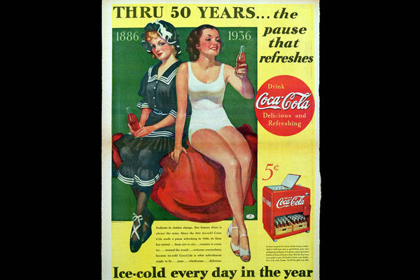 1936: An ad highlighting 50 years of Coca-Cola.
