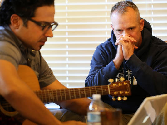 Songwriter Jay Clementi works on a song with Sgt. 1st Class Scott McRae at the weekend retreat near Fort Hood in Central Texas.