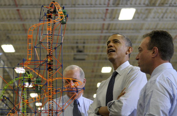 President Obama looks over a roller coaster with K'Nex inventor and Chairman Joel Glickman (left) and President and CEO Michael Araten on Friday during a tour of the company in Hatfield, Pa.