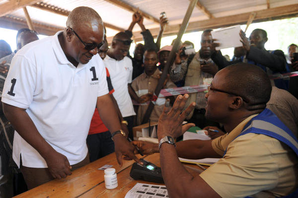 Ghana's President John Dramani Mahama arrives at a polling station to cast his vote.
