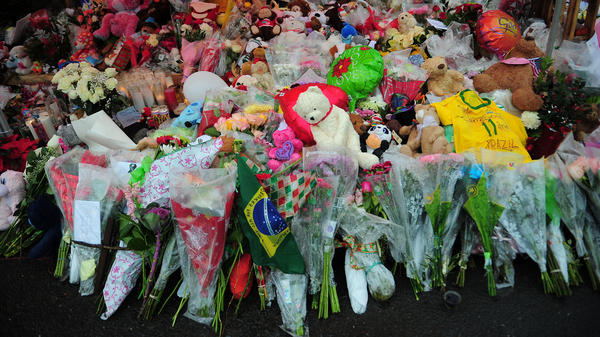 A makeshift shrine to the victims of the school shooting in Newtown, Conn. Slate and a citizen journalist are trying to track gun deaths across the nation since that Dec. 14 mass shooting.
